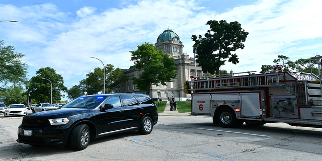 Kankakee Police and fire blockade the area of East Merchant Street following a shooting near the Kankakee County Courthouse, Thursday morning, Aug. 26, 2021, in Kankakee, Ill. Two people were killed and another was injured Thursday morning, Mayor Christopher Curtis said.