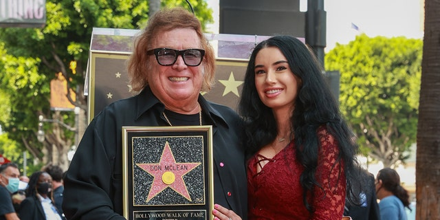 Don McLean and Paris Dylan pose as Musician Don McLean Honored With Star On The Hollywood Walk Of Fame on August 16, 2021 in Hollywood, Calif.