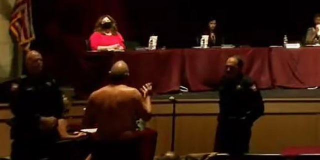 A shirtless James Akers, back on camera, addresses the school board in Dripping Springs, Texas, earlier this week.  (School board video image)