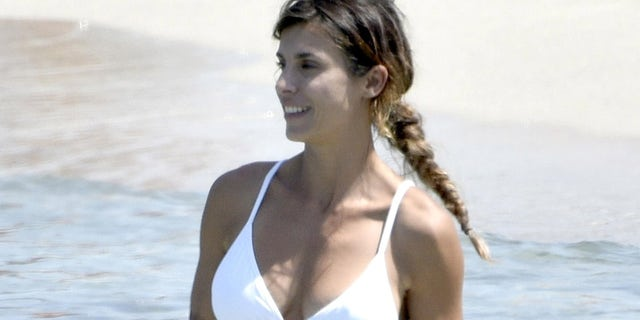 The star wore a pristine white bikini for her outing.