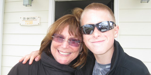 Judy Rogg and her late son Erik Robinson, 12, are pictured in March 2010.