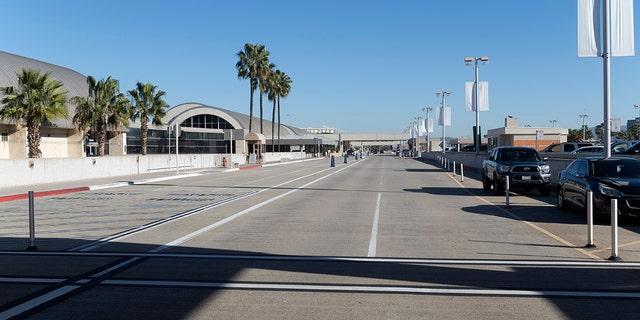 An empty crosswalk and drop-off for departing flights greets travelers at John Wayne Airport in Santa Ana, California, Jan. 26, 2021. (Getty Images)