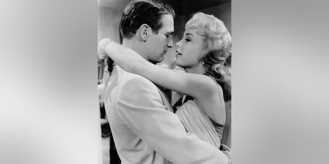 """Paul Newman and Barbara Eden appeared in Mark Robson's """"From the Terrace."""" Newman played David Alfred Eaton, a young man returning from the war in Europe, who tries to make a career and make himself a living.?"""