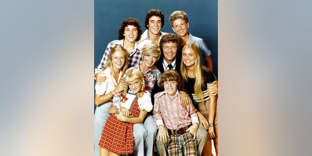 Pictured, top row: Christopher Knight (Peter), Barry Williams (Greg), Ann B. Davis (Alice);  middle row: Eve Plumb (Jan), Florence Henderson (Carol), Robert Reed (Mike), Maureen McCormick (Marcia);  bottom row: Susan Olsen (Cindy), Mike Lookinland (Bobby).