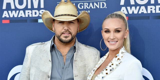 """Brittany Aldean says she and her husband, country singer Jason Aldean"""" are """"stopped multiple times per day"""" and thanked for being open politically."""