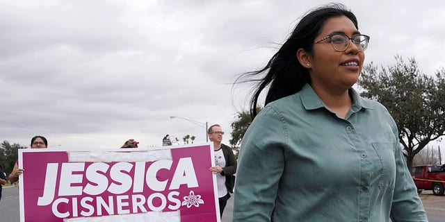 Democrat Jessica Cisneros, who is campaigning for a House seat, participates in the Citrus Parade to introduce herself to the attendees in Mission, Texas, Jan. 25, 2020. (REUTERS/Veronica Cardenas)