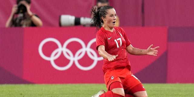 Canada's Jessie Fleming celebrates scoring the opening goal from the penalty spot during a women's semifinal soccer match against United States at the 2020 Summer Olympics, Monday, Aug. 2, 2021, in Kashima, Japan. (AP Photo/Fernando Vergara)