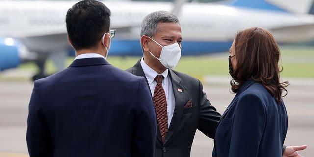 Vivian Balakrishnan, Singapore's foreign affairs minister, greets U.S. Vice President Kamala Harris upon her arrival in Singapore, Aug. 22, 2021. (Reuters)