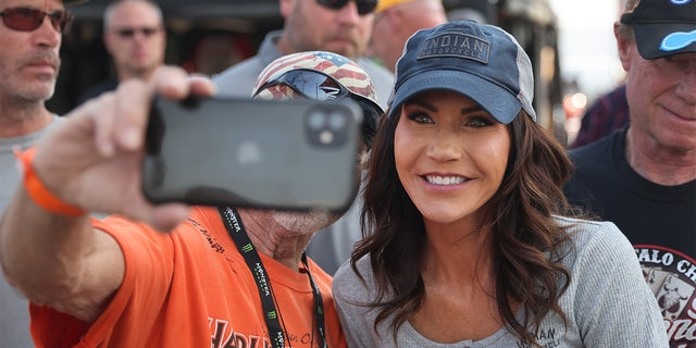 STURGIS, SOUTH DAKOTA - AUGUST 09: Governor Kristi Noem of South Dakota greets guests at the Sturgis Buffalo Chip campground after riding in the Legends Ride for charity on August 09, 2021 near Sturgis, South Dakota. (Photo by Scott Olson/Getty Images)