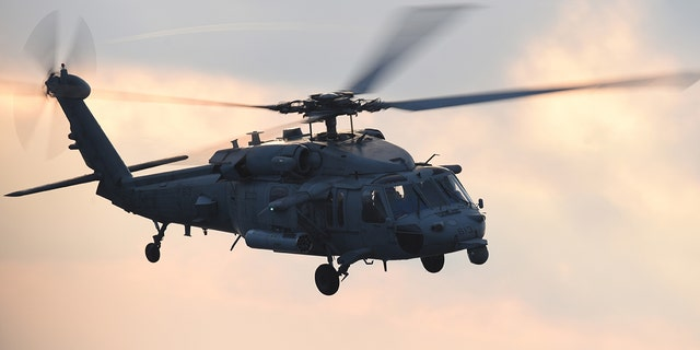 FILE: An MH-60S Seahawk helicopter performing routine flight operation, July 4, 2018. Image courtesy Petty Officer 3rd Class Thomas Gooley / USS Harry S Truman. (Photo by Smith Collection/Gado/Getty Images)