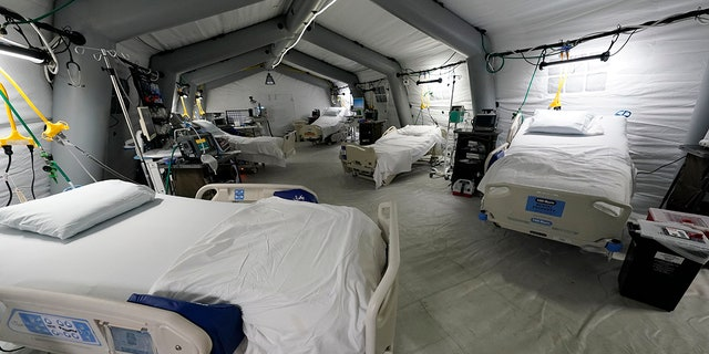 Aug. 17, 2021: Five intensive care beds, part of the 32-bed Samaritan's Purse Emergency Field Hospital, are set up in one of the University of Mississippi Medical Center's parking garages.