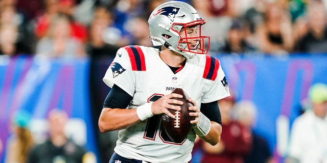 New England Patriots quarterback Mac Jones (10) drops back to pass during the second half of an NFL preseason football game against the New York Giants Sunday, Aug. 29, 2021, in East Rutherford, N.J. (AP Photo/John Minchillo)