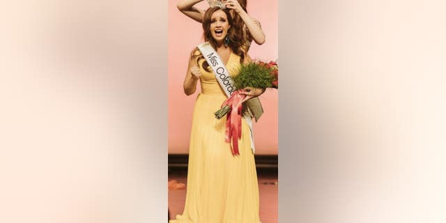 Army Spc. Maura Spence-Carroll is crowned Miss Colorado. She will compete in the Miss America pageant in December.