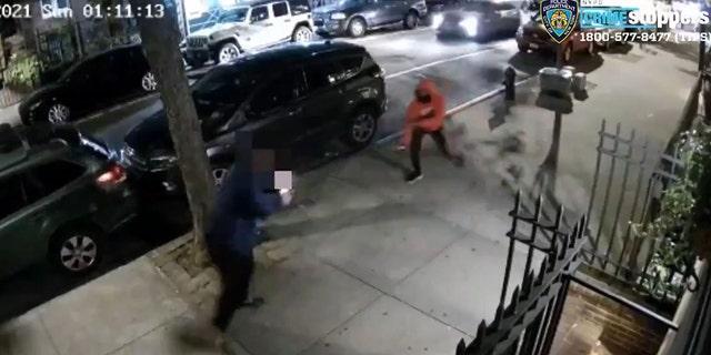 The suspect was seen brandishing a gun while robbing another man on a Manhattan sidewalk, police said.