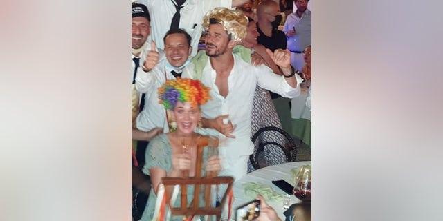 Katy Perry and Orlando Bloom were seen enjoying a rowdy night in the Taverna Anema e Core Nightclub in Capris, Italy.