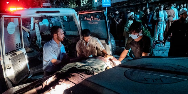 Victims of Thursday's attack at Kabul airport in Afghanistan arrive at the emergency surgical center for war victims.  (Reuters)