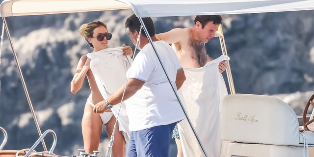 Jack Brooksbank looks to be having a great time aboard a yacht in Capri with several gal pals in attendance.