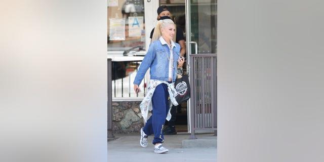 Gwen Stefani rocks custom Blake Shelton Vans in Los Angeles.