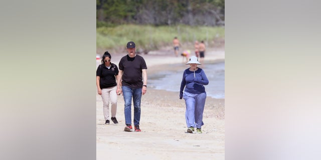 EXCLUSIVE: NO WEB BEFORE 5PM EST 25TH AUG 2021-- Bill Clinton and Hillary Clinton are spotted taking a walk along the beach near their home in The Hamptons. The couple just days ago celebrated Bill's 75th birthday, beginning down the beach, Bill dressed in jeans and a T-shirt, Hillary in sweats and a long-sleeve t-shirt and wide-brimmed hat, both wearing sneakers. They continue for about a half-mile before coming up on boardwalk where Hilary takes a break by sitting down, watched over by Secret Service Agents. Meanwhile, Bill heads up the stairs, towards what used to be the Belle Estate, and returns about 10 minutes later. The pair resume their walk another half mile with their Secret Service detail with them at all times. Pictured: Hillary Clinton,Bill Clinton Ref: SPL5248174 230821 EXCLUSIVE Picture by: Matt Agudo / SplashNews.com Splash News and Pictures USA: +1 310-525-5808 London: +44 (0)20 8126 1009 Berlin: +49 175 3764 166 photodesk@splashnews.com World Rights, No Poland Rights, No Portugal Rights, No Russia Rights