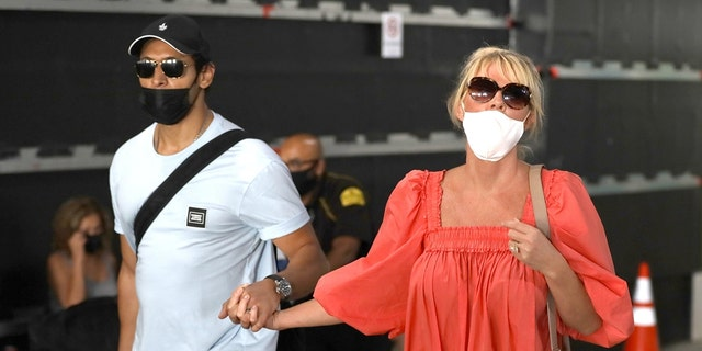 Sandra Lee of 'Semi-Homemade' arrives in Los Angeles with her fiancé Ben Youcef after an international getaway that took place amid the fallout of Andrew Cuomo's resignation from his position as governor of New York.