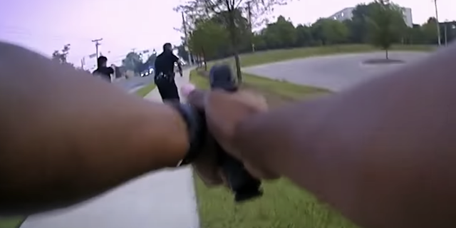"""Officer Cherell Kinchloe's actions """"in firing two shots given the vantage point represented by her video"""" are under review, police said."""