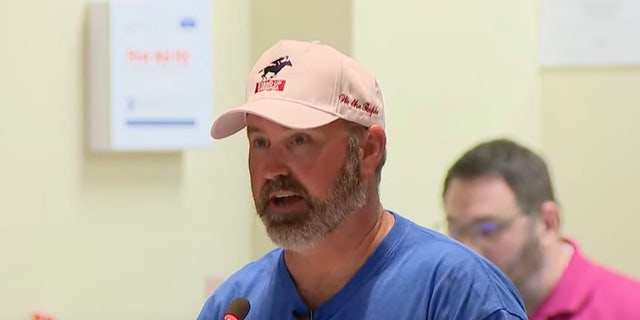 A man speaks at a Loudoun County School Board meeting on August 10.