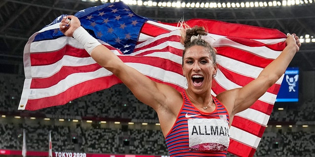 Valarie Allman, of the United States, poses after winning the gold medal in the women's discus throw final at the 2020 Summer Olympics, Monday, Aug. 2, 2021, in Tokyo. (AP Photo/David J. Phillip)