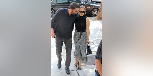 Well-dressed duo Ben Affleck and Jennifer Lopez wear matching outfits as they go shopping together at the Westfield mall in Los Angeles.