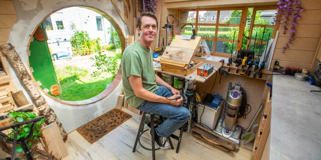 """Even though he still has some finishing touches to make, Hughson said he does most of his woodwork in the """"Hobbit house"""" now."""