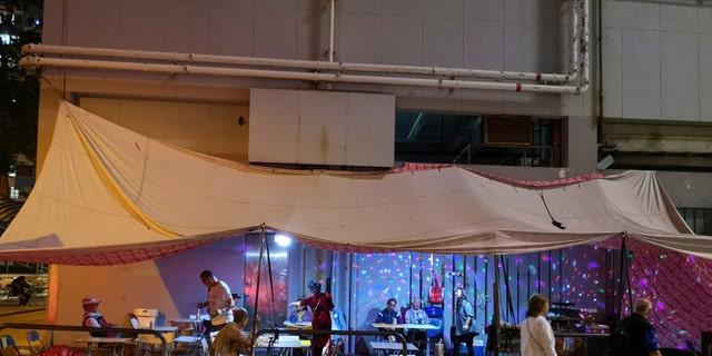 Local people performing Karaoke at a tent on a street in Yau Ma Tei, Kowloon peninsula. Hongkong