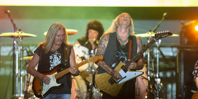 Mark Matejka (L) and Rickey Medlocke of Lynyrd Skynyrd perform on June 04, 2021 in Panama City Beach, Florida. (Photo by Michael Chang/Getty Images)