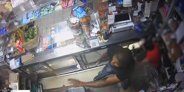 The video showed the man being chased hide behind the store counter and pull a gun.