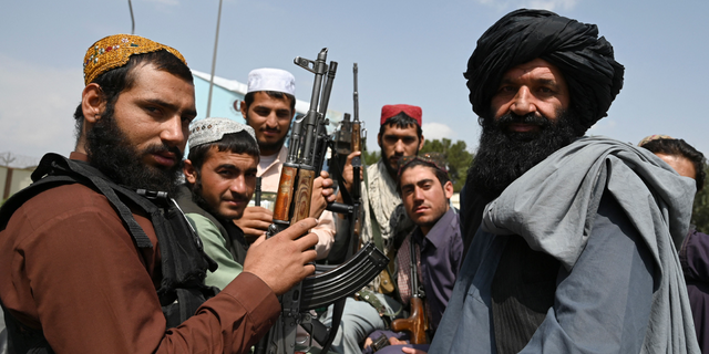 Taliban fighters sit on the back of a pick-up truck at the airport in Kabul on Aug. 31, 2021. (Getty Images)
