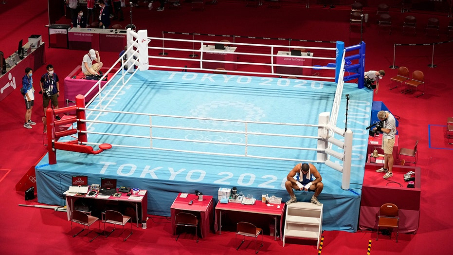 French boxer protests by sitting on ring apron after disqualification: 'The decision was so unfair'
