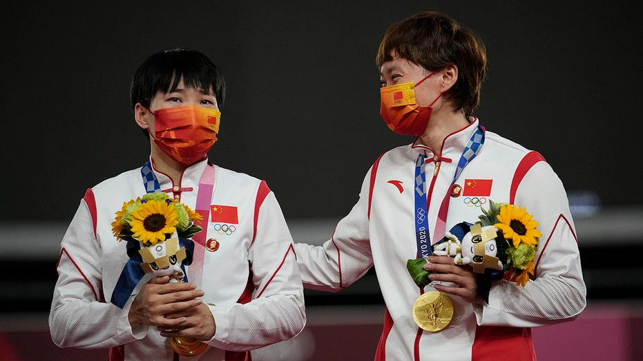 Chinese Olympic gold medalists' Mao pins subject of IOC probe