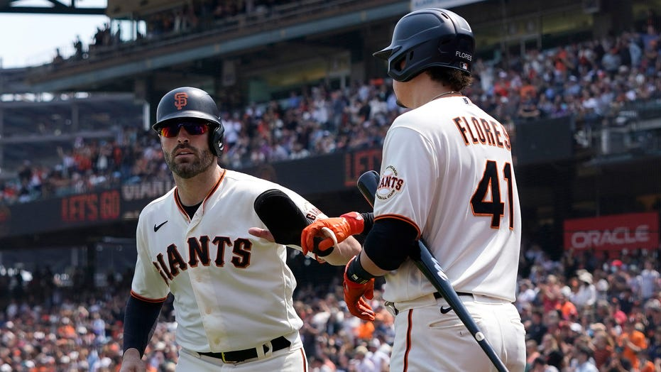 Giants holding off more celebrated NL West rivals