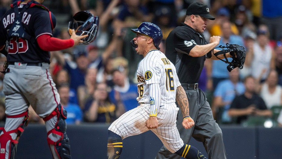 Yelich drives in 6 runs, powers Brewers past Washington 9-6