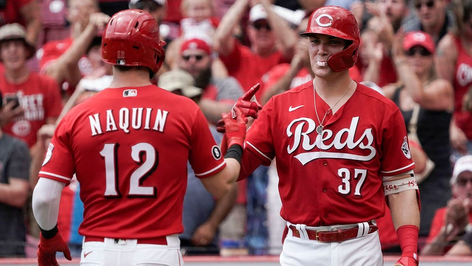Naquin homers twice, Reds beat Marlins 3-1 to sweep series