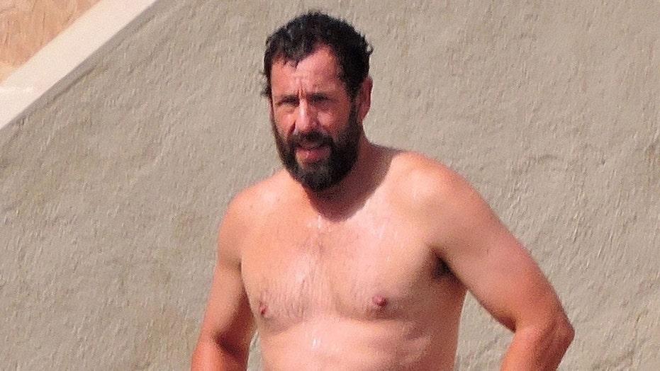 Adam Sandler hits beach during getaway in Spain while filming new movie 'Hustle'