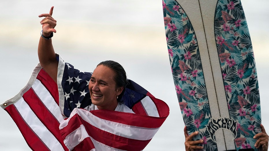 Native Hawaiians 'reclaim' surfing with Moore's Olympic gold