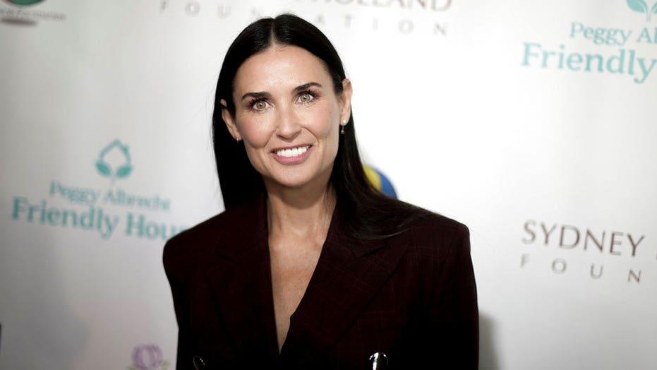 Demi Moore sizzles in one-piece swimsuit in honor of 'red hot summer'