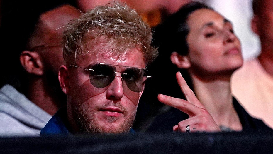 Jake Paul shows off LED lights on trunks ahead of Tyron Woodley fight