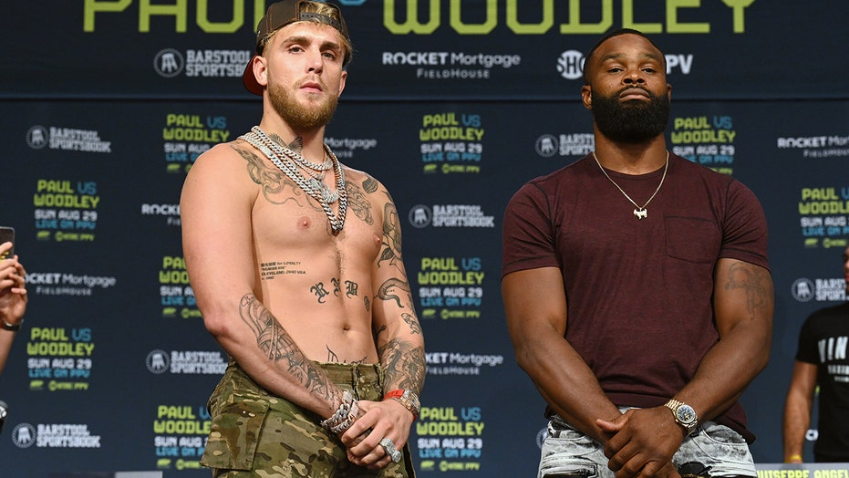 Jake Paul, Tyron Woodley pre-fight news conference marred by scuffle