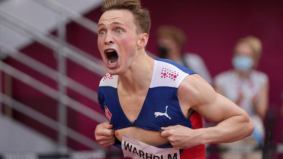 Norway's Karsten Warholm breaks his own 400-meter hurdles world record, rips shirt in celebration