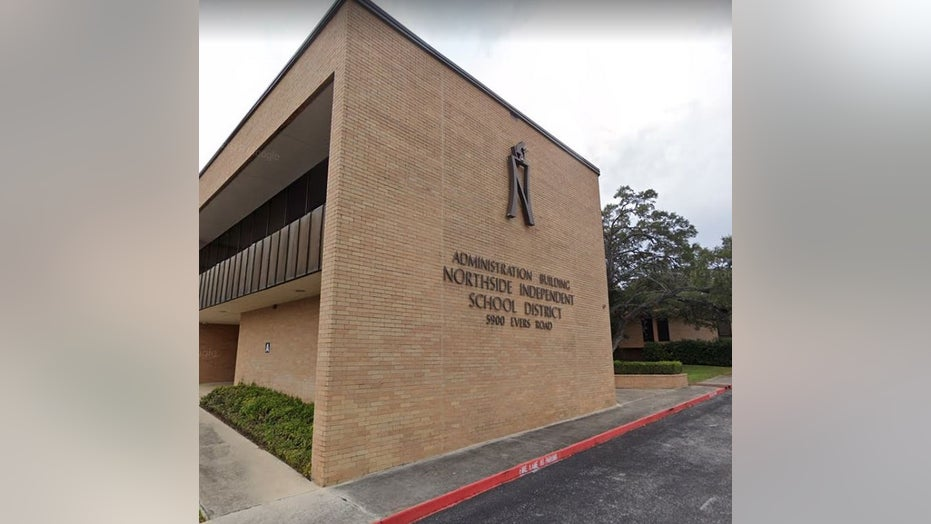 Woman carried by cops while seated from Texas school board meeting for refusing to wear mask, district says