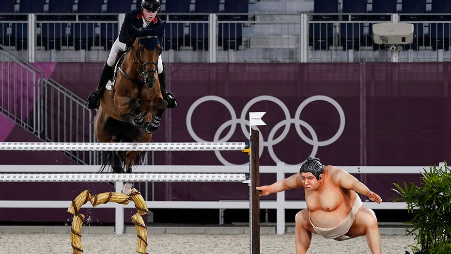 Olympic riders suggest sumo statue scaring horses: 'It is very realistic'