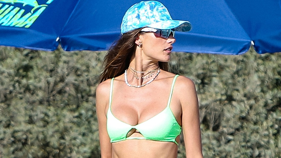 Supermodel Alessandra Ambrosio unveils her toned abs in neon-green bikini during beach outing