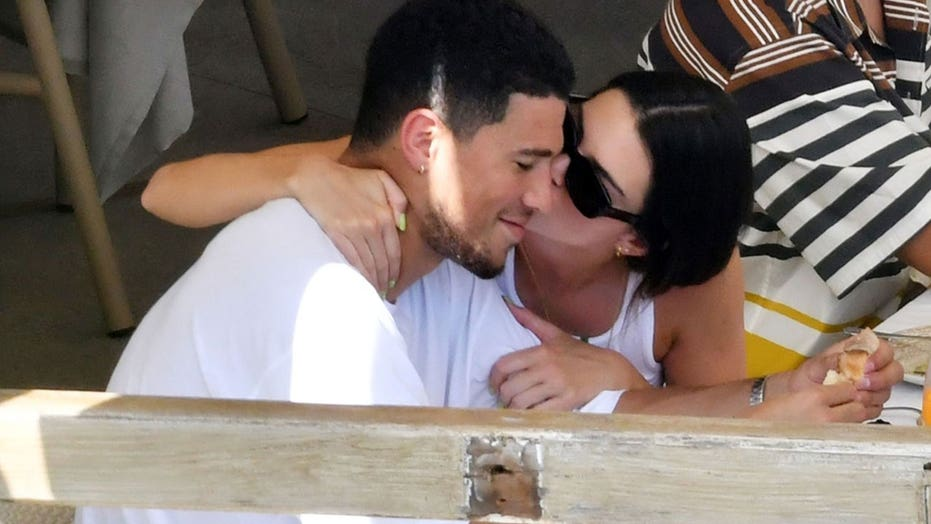 Kendall Jenner and beau Devin Booker spotted showing rare PDA while on romantic Italian getaway