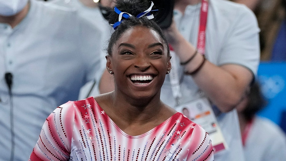 Simone Biles fans cheer on gymnast as she wins bronze medal
