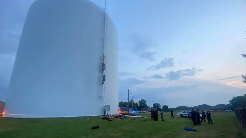 Alabama firefighters rescue woman found swimming in 70-foot-high water tank